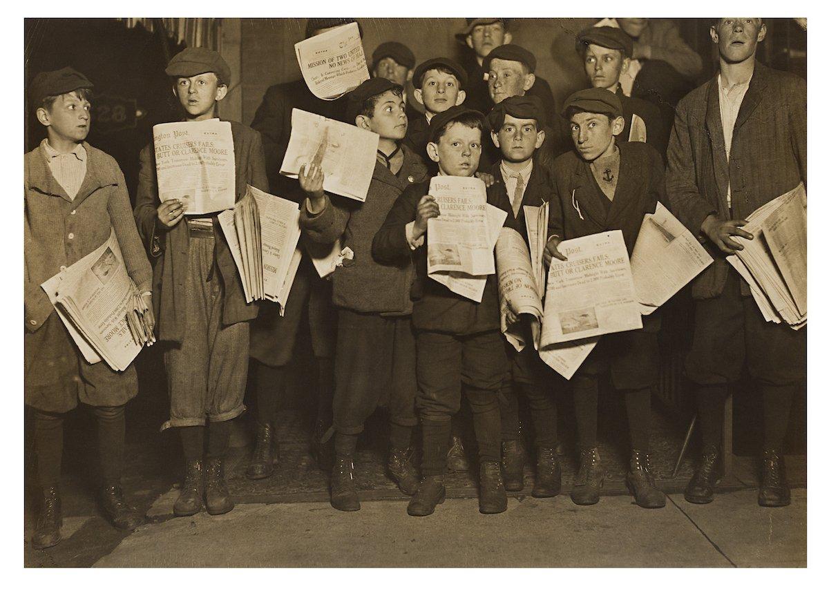 Newsboys (circa 1909), a photo on gelatin silver print by Lewis Hine.